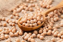 Raw chick peas organic vegetarian nutrition super food in wooden Stock Photos