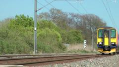 Commuter train rural cxountryside setting movement Stock Footage
