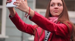 Young woman make selfie on streer with digital tablet Stock Footage