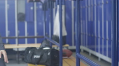 4K Portrait of attractive smiling woman in gym locker room Stock Footage