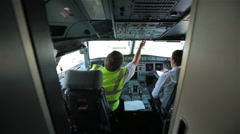 Glass cockpit cabin security door captain copilot switch electronics deck Airbus - stock footage