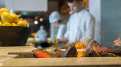 Selective focus on burning fire in restaurant kitchen - stock footage