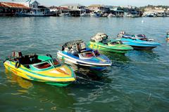 Four speedboats are anchored Stock Photos