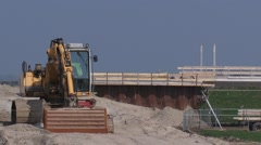 Shovel on sandpile + pan bridge under construction + temporary batch plant Stock Footage