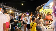 People at the Train Night Market in Bangkok Stock Footage