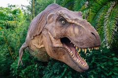 ORLANDO, FLORIDA NOVEMBER 6th: A T-Rex stands between the bushes with his mouth Stock Photos