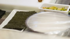 Vertical dolly shot of Japanese kitchen and chef preparing Stock Footage