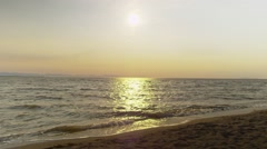 Beautiful Golden Sun over Beach Stock Footage
