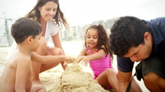 Brazilian Family plays on a beach in Brazil Stock Footage