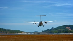 Small Commuter Plane Lands at Phuket International Airport in Thailand Stock Footage