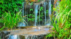 Water Cascading over an Artificial Garden Waterfall Stock Footage
