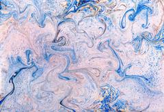 Swirling blue and white marbled paper - stock photo
