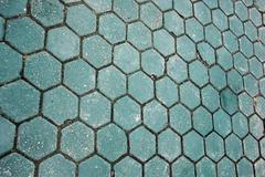 honeycomb pattern of the green paving blocks - stock photo
