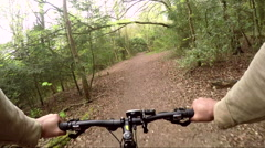 Biker going through the woods Stock Footage