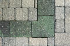 Stock Photo of Corner pattern in grey brick paving