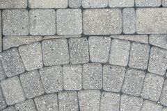 Circular inlaid pattern in grey brickwork Stock Photos