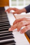 Man playing the piano Stock Photos