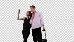K14A8773  - Couple, hand in hand, trolly, takes selfie.. Stock Footage