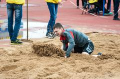 Stock Photo of Men compete in long jump, Orenburg, Russia