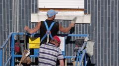 Mason prepares sill restoration Stock Footage