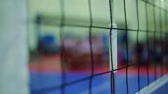 Close-up of Volleyball net and shot of players during Time-out Stock Footage