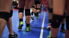 Legs of Volleyball Players walking by after game with knee pads on Stock Footage