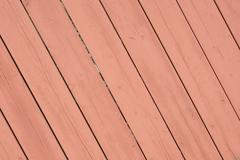 Old pink rose colored diagonal wooden surface Stock Photos