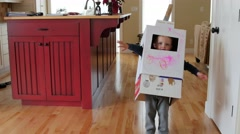 A boy playing in a homemade robot costume Stock Footage
