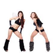 Two beautiful naughty go-go dancers - stock photo