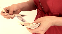 Woman red dress counts british money Stock Footage