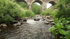 stone bridge over the brook - stock footage