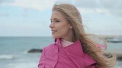 Romantic girl dreaming at sea coast Stock Footage