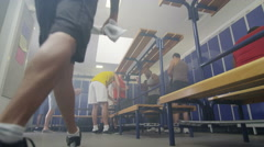 4K Cheerful sports players or gym buddies getting changed in men's locker room - stock footage