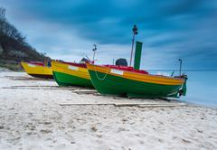 Landscape with Baltic Sea. Fishing boat on the beach. Tranquil evening landsc Stock Photos