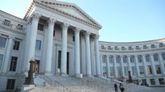 Denver city and county building walking up steps - stock footage