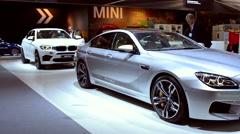 BMW X6 M SUV and 6 Series Gran Coupe sedan - stock footage