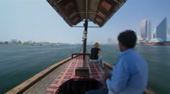 Trip on traditional Abra boat at the creek in Dubai, UAE timelapse Stock Footage