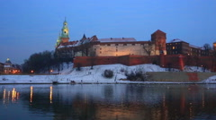 Wawel castle and the Vistula River in Krakow in winter night Stock Footage