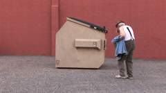 Homeless Alcoholic Spits Near Dumpster 8 in series Stock Footage