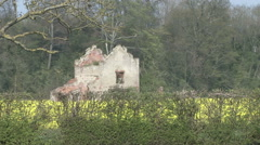 Derelict chapel in oil seed rape field. Stock Footage