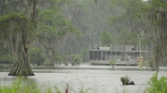 Swamp scene with houseboat and cypress trees - stock footage