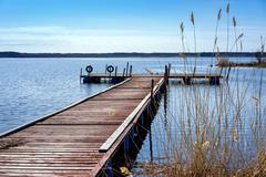 Pier for pleasure and fishing boats on shore of Lake Ladoga in Karelia. In th Stock Photos