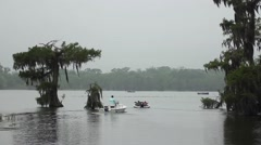 Motorboat heading out into lake Stock Footage
