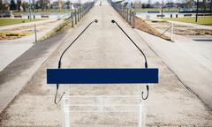 Microphones on lectern outside with deofused view of a bridge over a river in Stock Photos