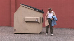 Homeless Old Man Staggers Around Dumpster 11 in series - stock footage