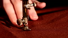 Woman's hands behind her sewing process on brown tissue Stock Footage