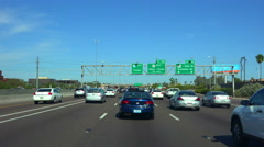 Stock Video Footage of 4K UHD congested freeway heading east I-10 sign to Tucson