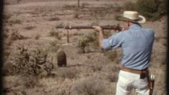 Man Aims Shoots Antique Rifle 1970s Vintage Film Home Movie Retro 8207 Stock Footage