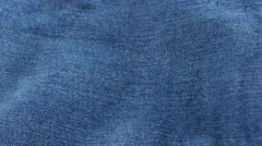 Blue jeans pocket on brown cloth, cam moves to the left, close up - stock footage