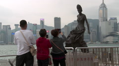 Tourist Taking Pictures on the Avenue of the Stars Statue Anita Mui Stock Footage